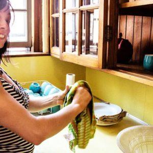 Sangita washing dishes